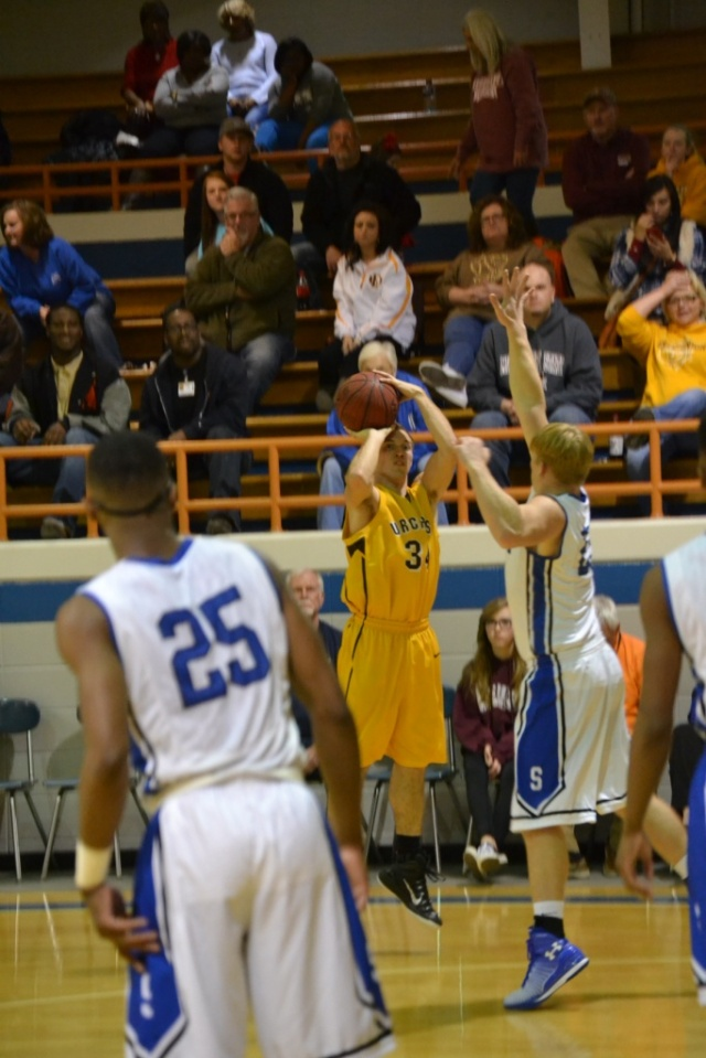 Craig Hutchens shoots from the corner. Photo by Dennis Clayton.
