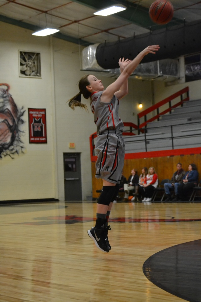 Presley Goolsby with the three point attempt in the first half for Myrtle. Photo by Dennis Clayton.