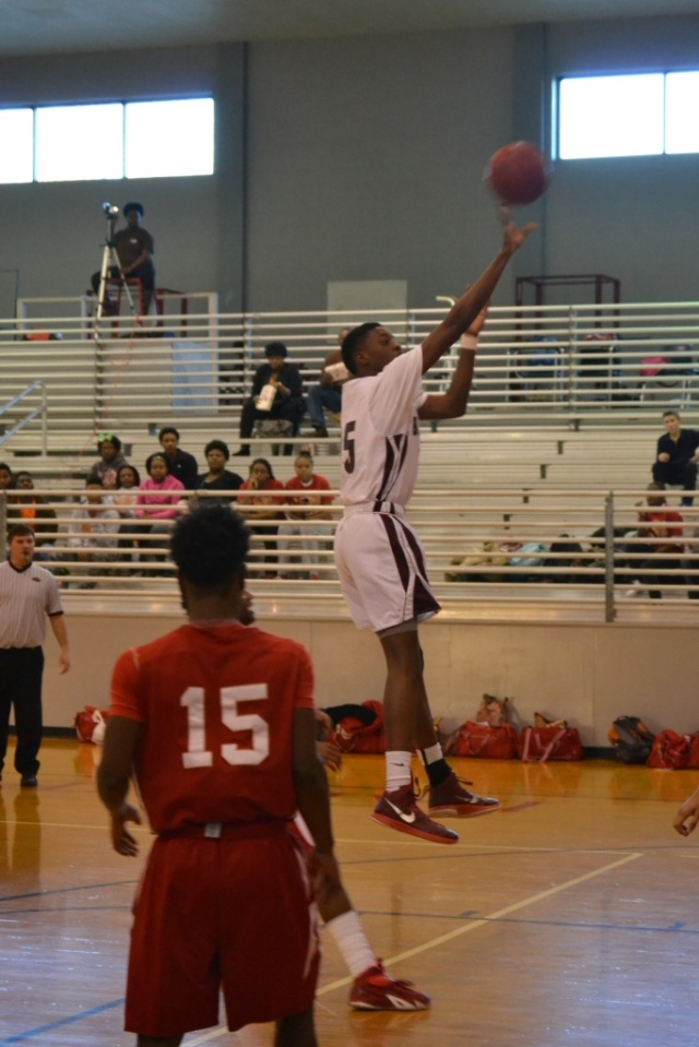 Miles Washington shoots the short jumper in the lane. Photo by Dennis Clayton.