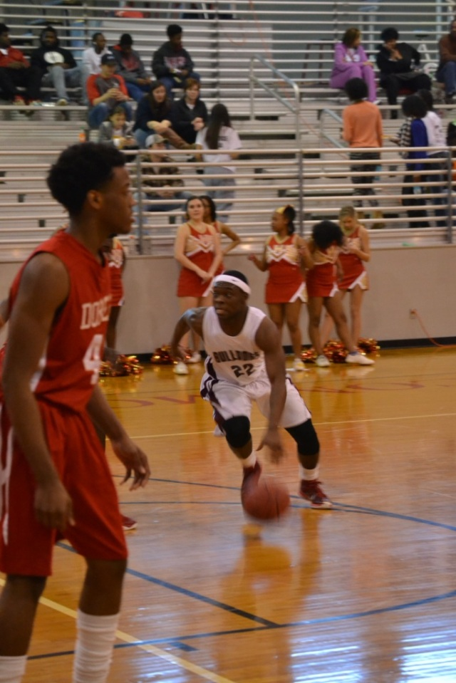 Jarel Lipsey dribbles into the lane for the score. Photo by Dennis Clayton.