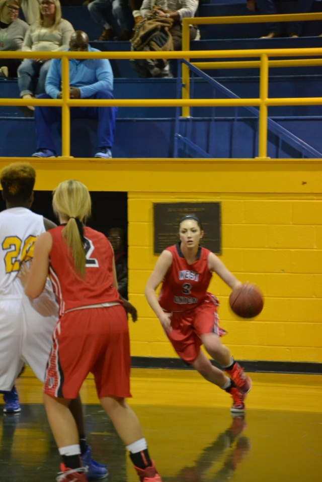Marley Long drives along the baseline for the Lady Eagles. Photo by Dennis Clayton.