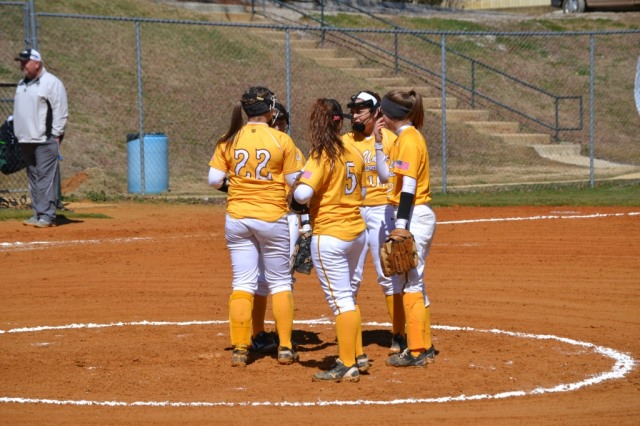 Lady Urchin infield meets at the mound before the first pitch. Photo by Dennis Clayton.