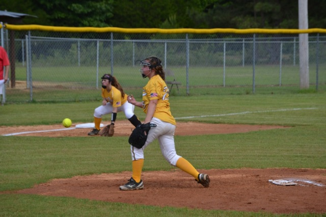 Savannah Greer fires the pitch to the plate during the first inning of game one against Wheeler. Photo by Dennis Clayton.