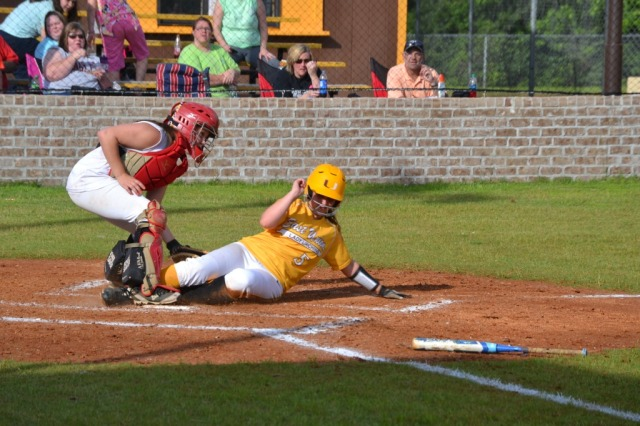 Sallie Pannell slides under the tag to score a run in the East Union first. Photo by Dennis Clayton.
