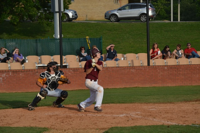 Austin Gafford drives his single into left. Photo by Dennis Clayton.