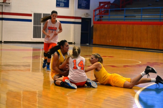 "A scramble for the ball on the floor is always fun to me. It looks as if Tianna Castillo has taken the ball away from Maggie Garrett and Katie Rowan is about to ""take her ball and go home""."