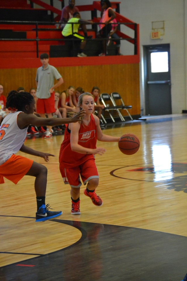 Savannah Shirley drives past the North Pontotoc defender in West Union's opening game at Myrtle on Monday. Photo by Dennis Clayton.
