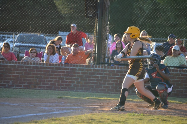 Rebecca Sheffield hits a two-run homer in the first. Photo by Dennis Clayton
