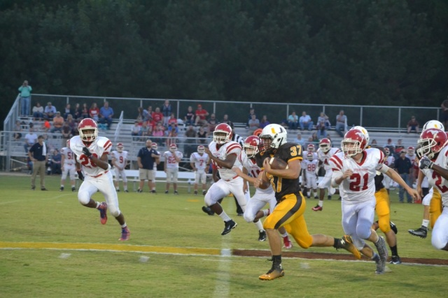 Craig Hutchens races into the Strayhorn secondary on this 23-yard gain in the first quarter. Photo by Dennis Clayton.