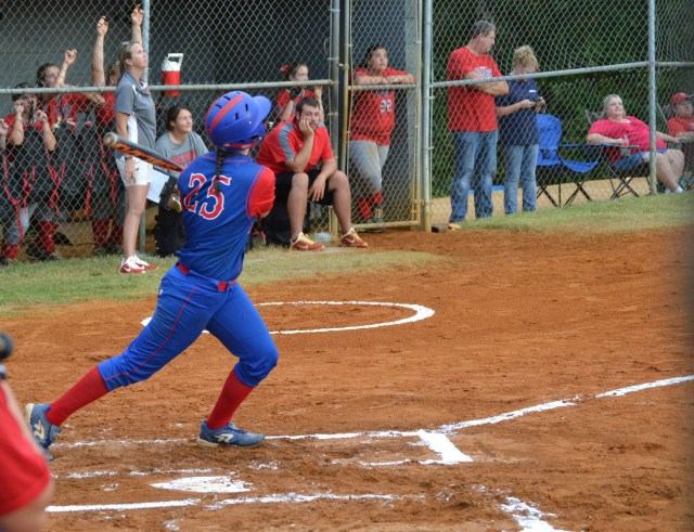 Lauren Thompson launches her three-run homer in the second inning. Photo by Dennis Clayton.